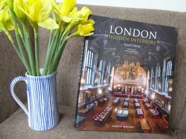 Three items for a great January afternoon: a sofa, a bunch of daffodils and Philip Davies' sumptuous book: London - HIdden Interiors.